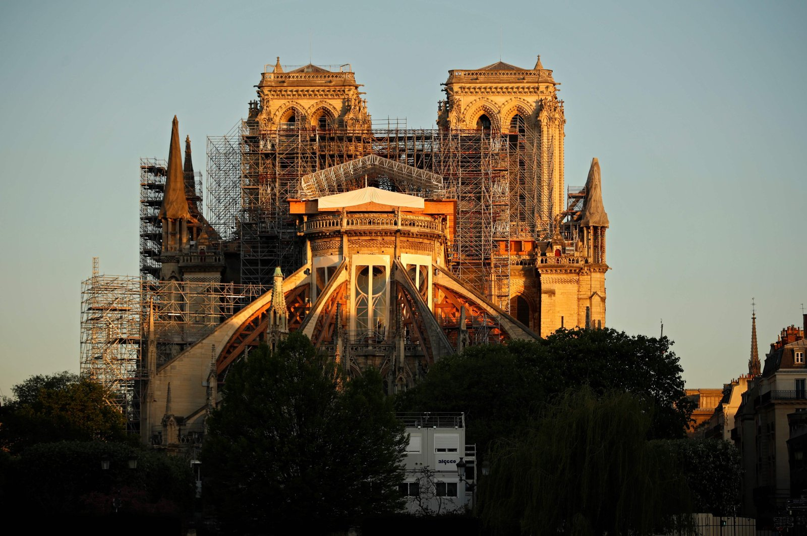 Notre Dame Cathedral is seen at sunrise on the eve of the first anniversary of the violent fire that destroyed a large part of the monument, on the 29th day of a lockdown in France to stop the spread of COVID-19, Paris, France, April 14, 2020. (AFP Photo)
