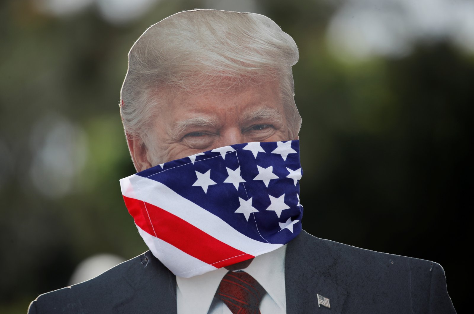 A cardboard cutout of U.S. President Donald Trump wearing a mask is seen at a protest over the stay-at-home orders involving the closure of beaches and walking paths during the outbreak of the coronavirus in Encinitas, California, U.S., April 19, 2020. (Reuters Photo)