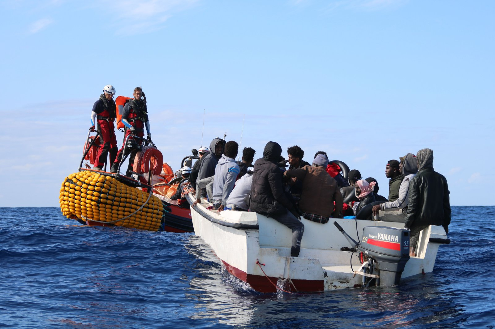 SOS Mediterranee team members from the humanitarian ship Ocean Viking approach a boat in distress with 30 people on board in the waters off Libya, Nov. 20, 2019. (AP Photo)
