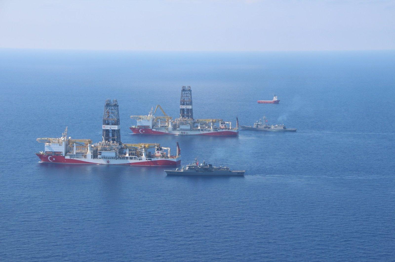 Turkey's drillships Fatih and Yavuz in the Eastern Mediterranean along with Turkish Navy vessels. (IHA File Photo)
