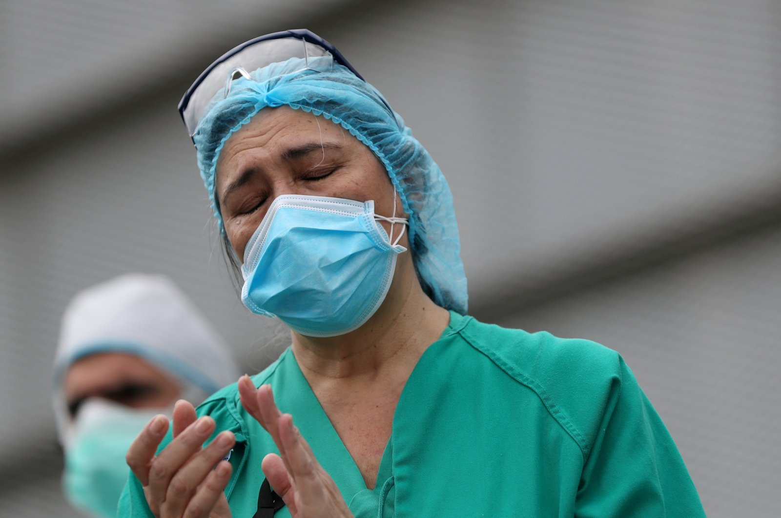 Staff from Segovia's General Hospital react during a minute of silence to remember a hospital worker, Segovia, Spain, April 23, 2020. (Reuters Photo)