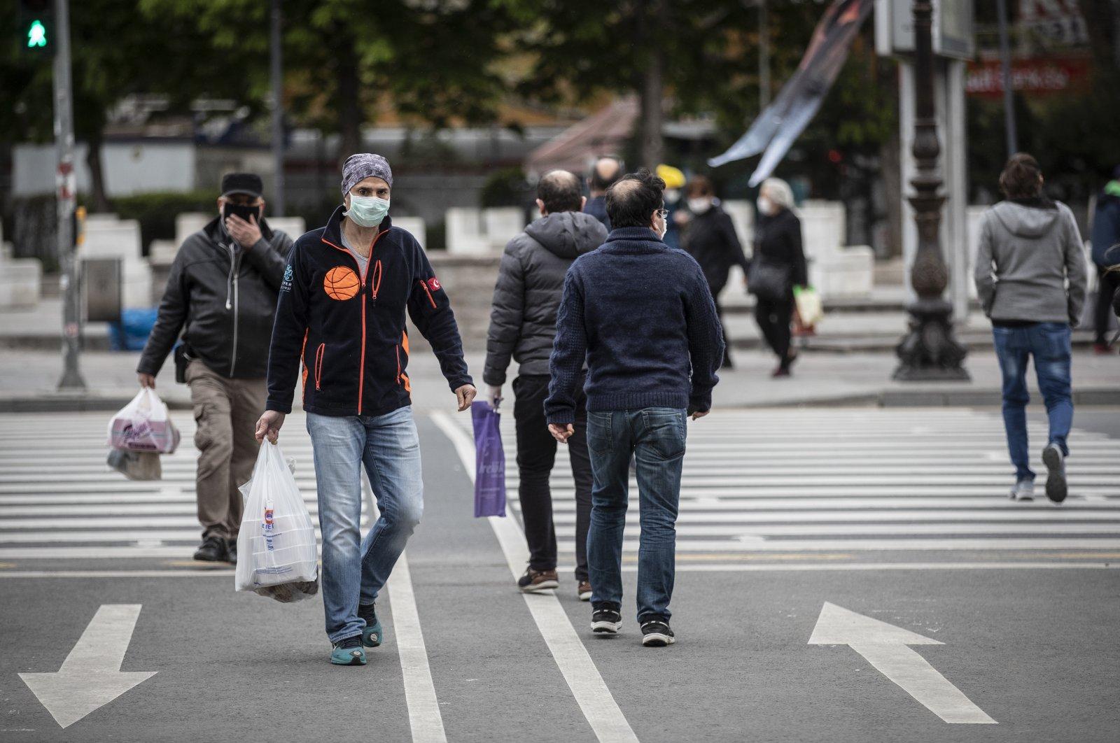 People wearing masks walk the streets of the capital Ankara, Turkey, April 23, 2020. (AA Photo)