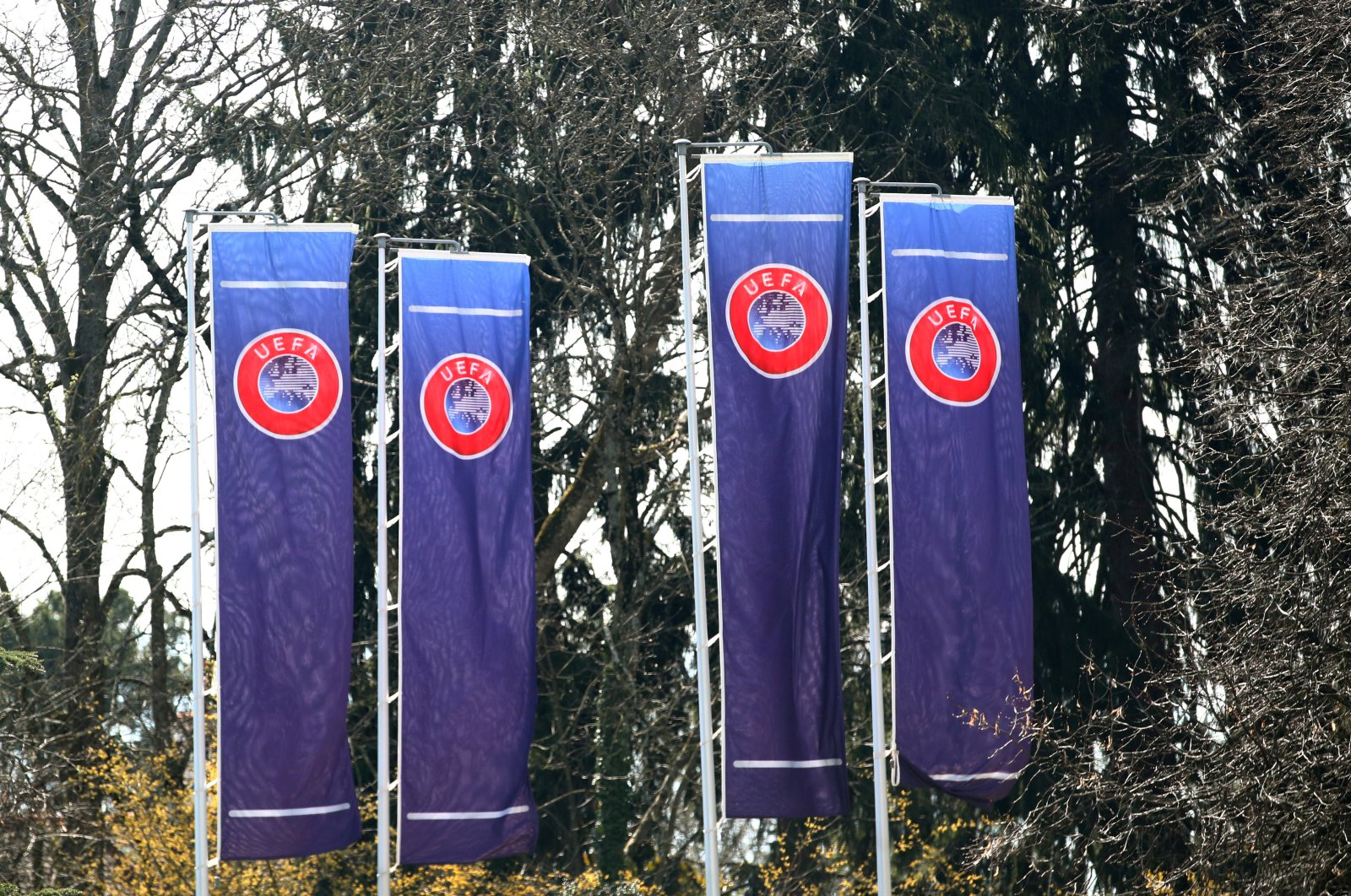 Flags posted outside the headquarters of the UEFA before an executive committee meeting in Nyon, Switzerland, March 17, 2020. (Reuters Photo)