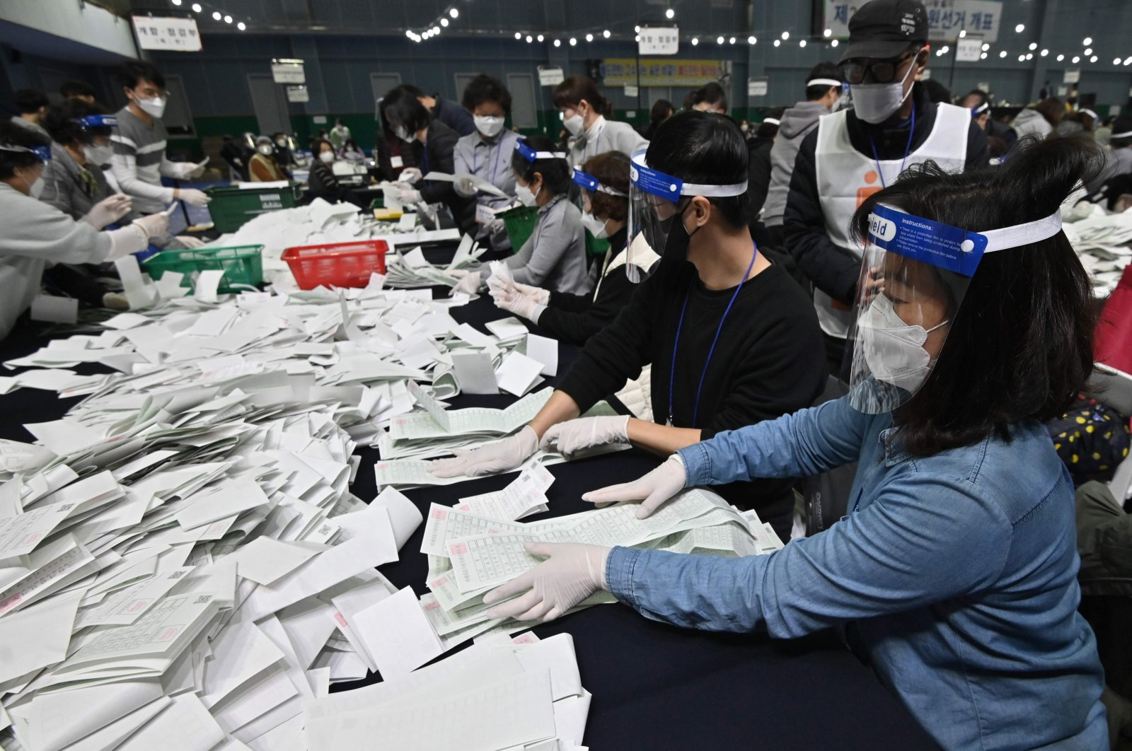 South Korean election officials sort voting papers for ballot counting in the parliamentary elections at a gymnasium in Seoul, South Korea, April 15, 2020. (AFP Photo)