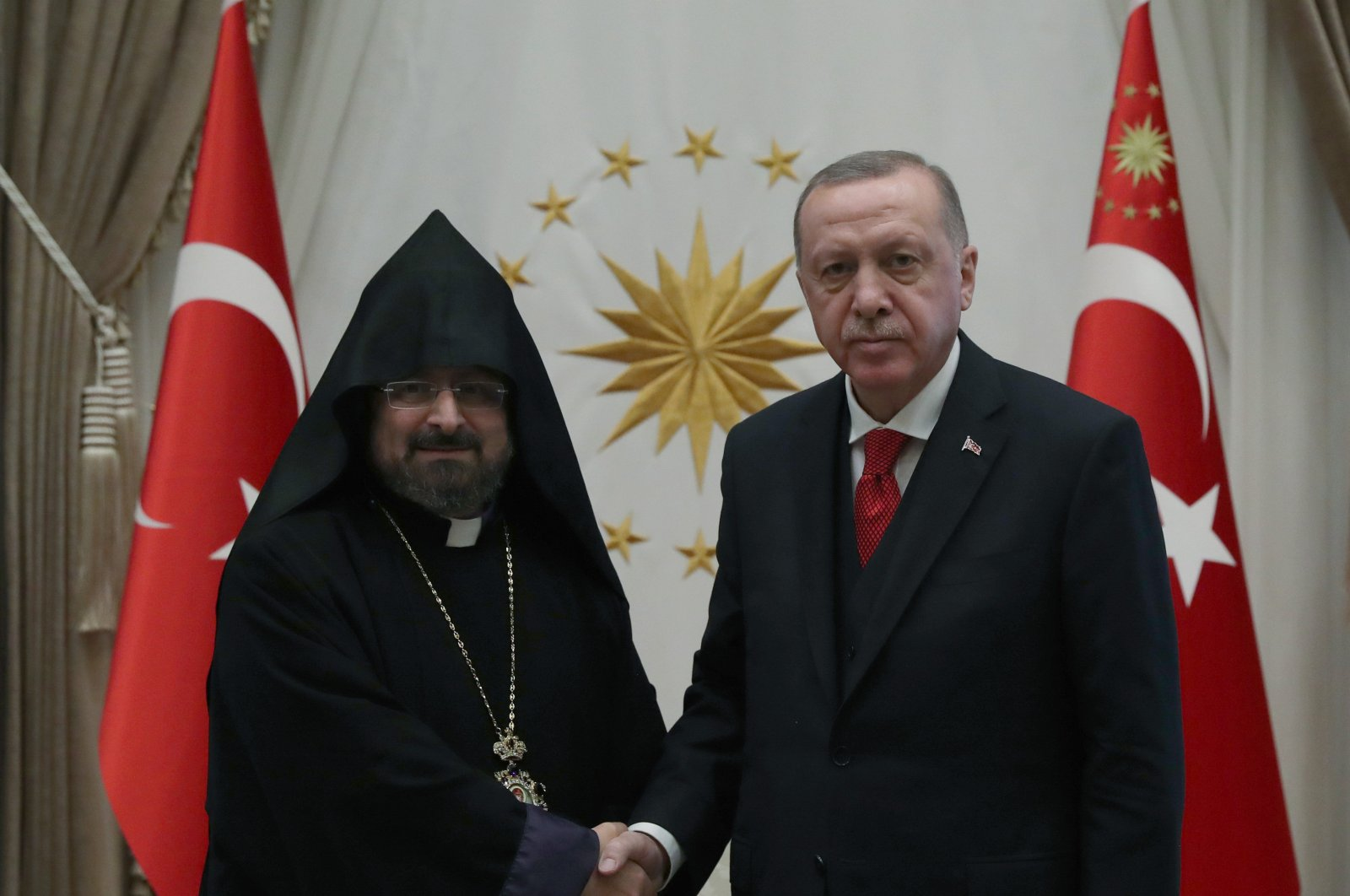 President Recep Tayyip Erdoğan (right) shakes hands with Armenian Patriarch Sahak Maşalyan at the Presidential Complex in Ankara on January 15, 2020 (AA File Photo)