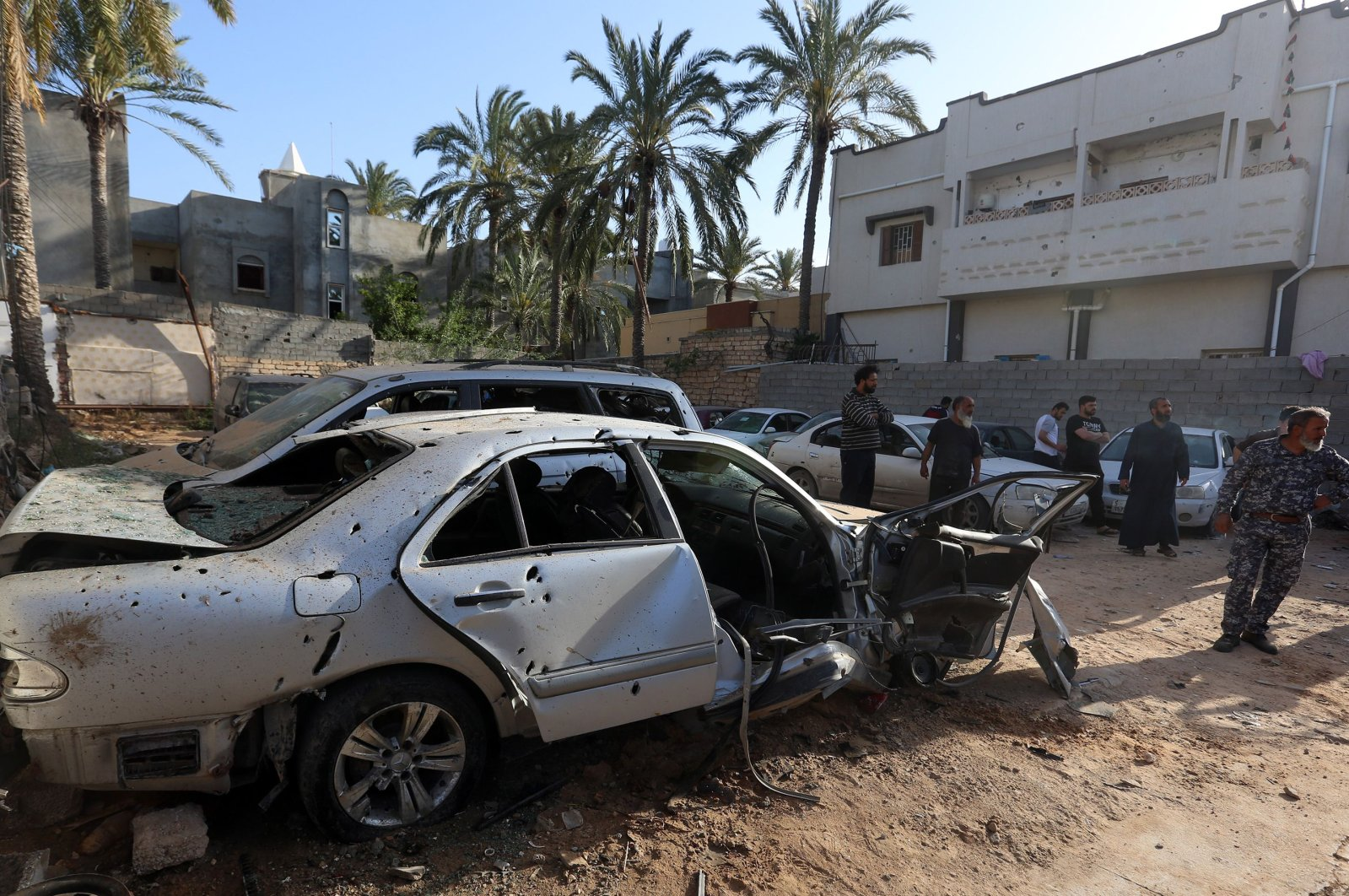 Libyans check the site of shelling on the residential area of souq al-Gomaa, north of the Libyan capital Tripoli, on April 17, 2020. (AFP Photo)