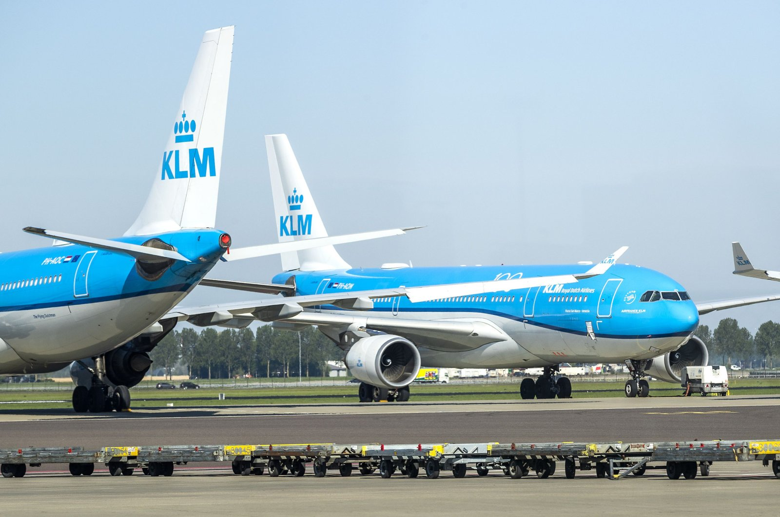KLM aircraft are seen at a standstill on the tarmac of Schiphol airport, on April 23, 2020, as the country is under lockdown to stop the spread of the Covid-19 pandemic caused by the novel coronavirus. (AFP Photo)