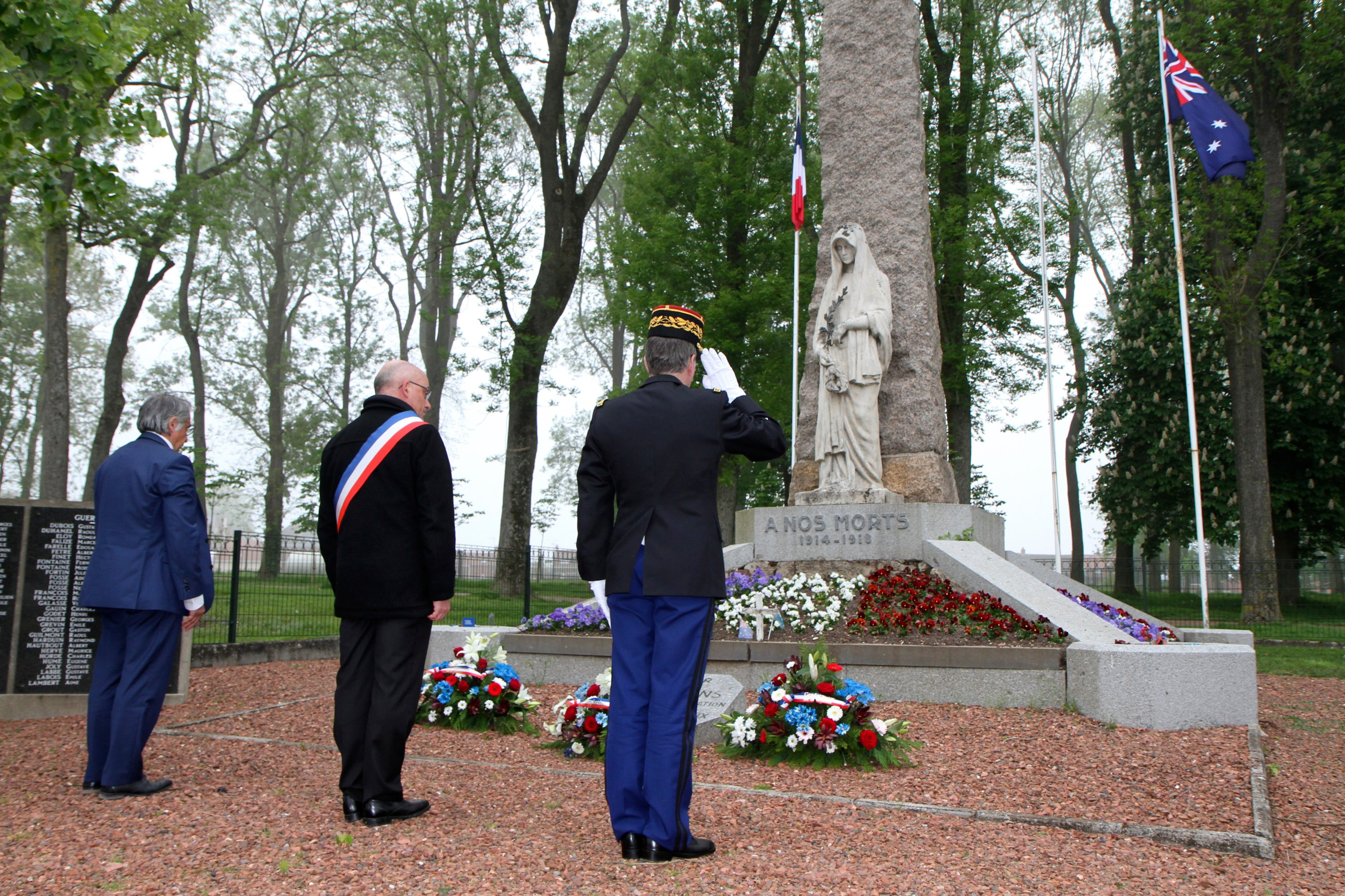 Deputy Mayor Benoit Decottegnie (C) and other French officials lay a wreath of flower at the monument to victims of World War I to mark Anzac Day in Villers-Brettoneux, northern France, Saturday April 25, 2020. (AP Photo)