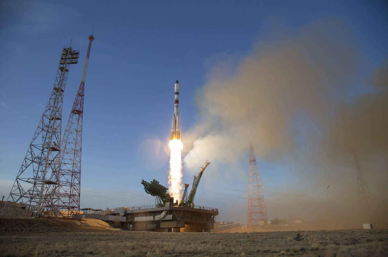 In this photo distributed by Roscosmos Space Agency Press Service, the Russian Progress MS-14 cargo spacecraft blasts off from the launch pad at Russia's space facility in Baikonur, Kazakhstan Saturday, April 25, 2020. (AP Photo)