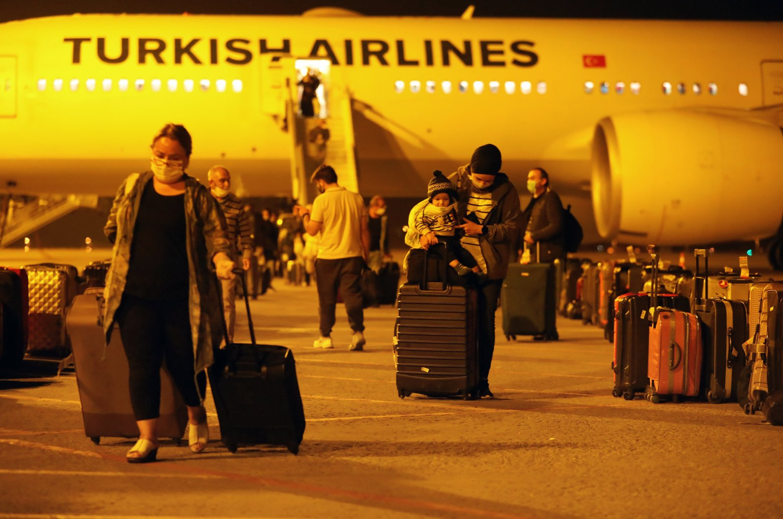 Turkish citizens repatriated from Morocco disembark a Turkish Airlines aircraft in capital Ankara, on April 24, 2020. (AA Photo)