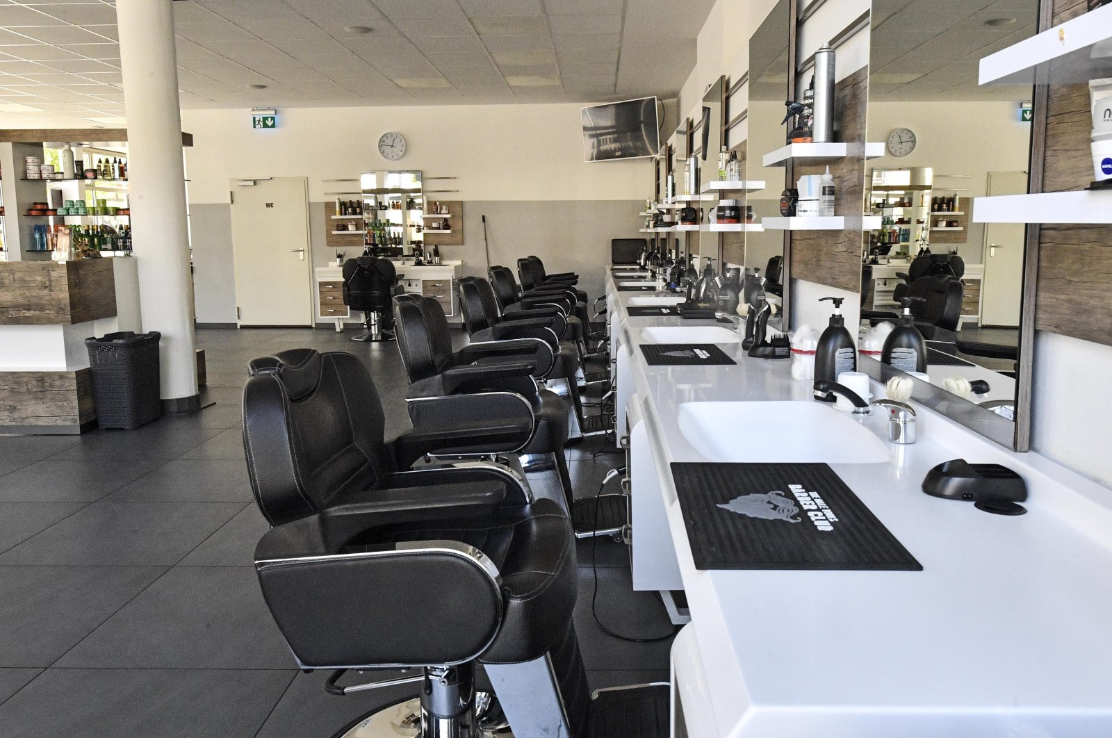 A hairdresser's shop is still closed in Gelsenkirchen, Germany, as many smaller stores are allowed to open on Monday, April 20, 2020. (AP Photo)