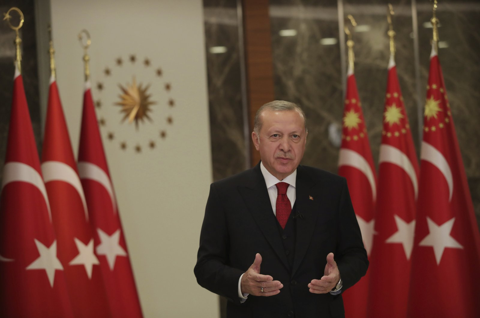 President Recep Tayyip Erdoğan stands during an event to mark Turkey's National Sovereignty and Children's Day, in Istanbul, April 23, 2020. (AP Photo)