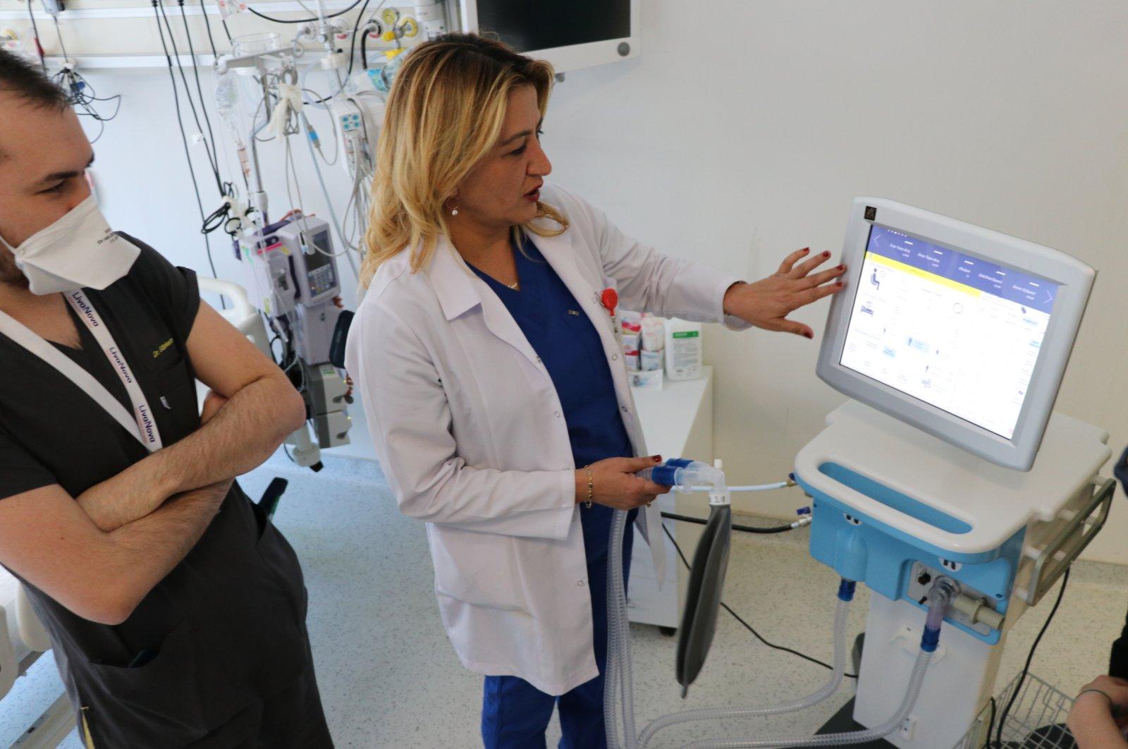 Sema Kultufan Turan (R), a member of Health Ministry's Coronavirus Science Board, tests the domestically made ventilator at a hospital in Ankara, Turkey, April 24, 2020. (AA Photo)