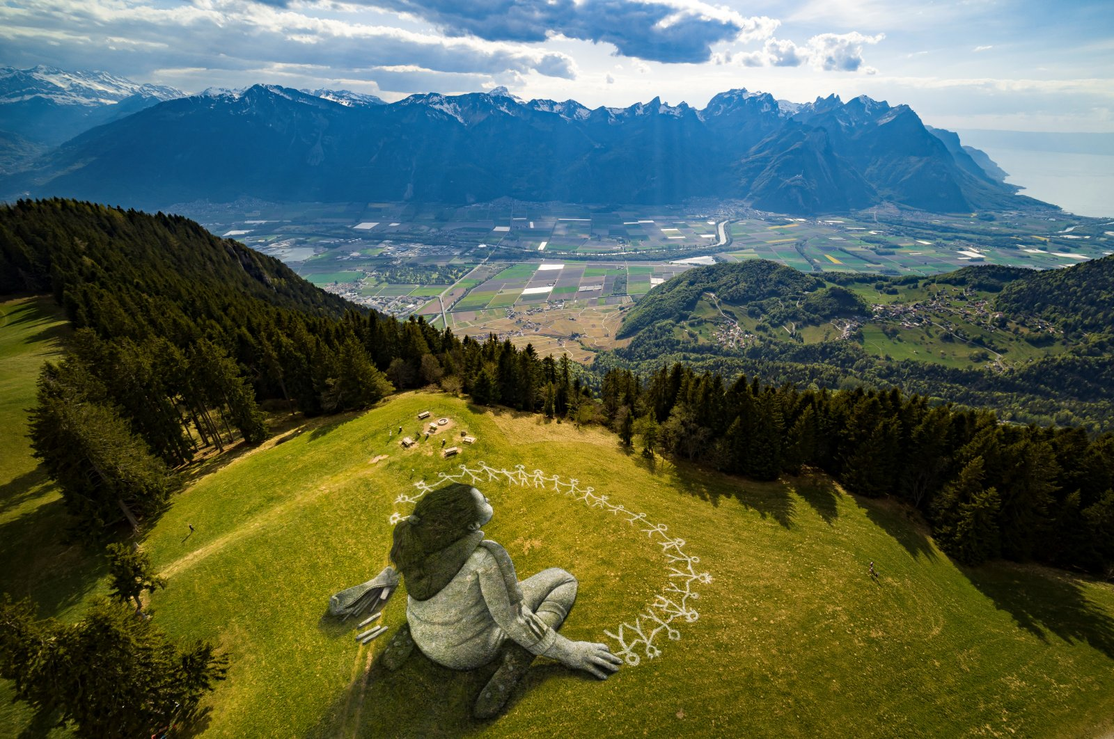 """An artwork called """"Beyond Crisis"""" by French artist Guillaume Legros aka Saype and created with an eco paint made out of chalk and coal over a 3,000-square-meter field is pictured during the coronavirus disease outbreak in Leysin, Switzerland, April 24, 2020. (Reuters Photo)"""