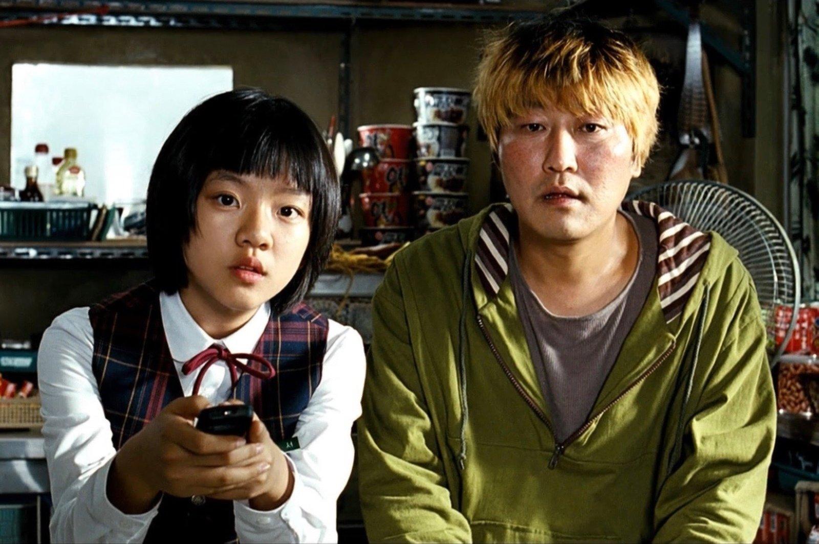"Hyun-seo (Go Ah-sung) and Gang-du (Song Kang-ho) in ""The Host""."