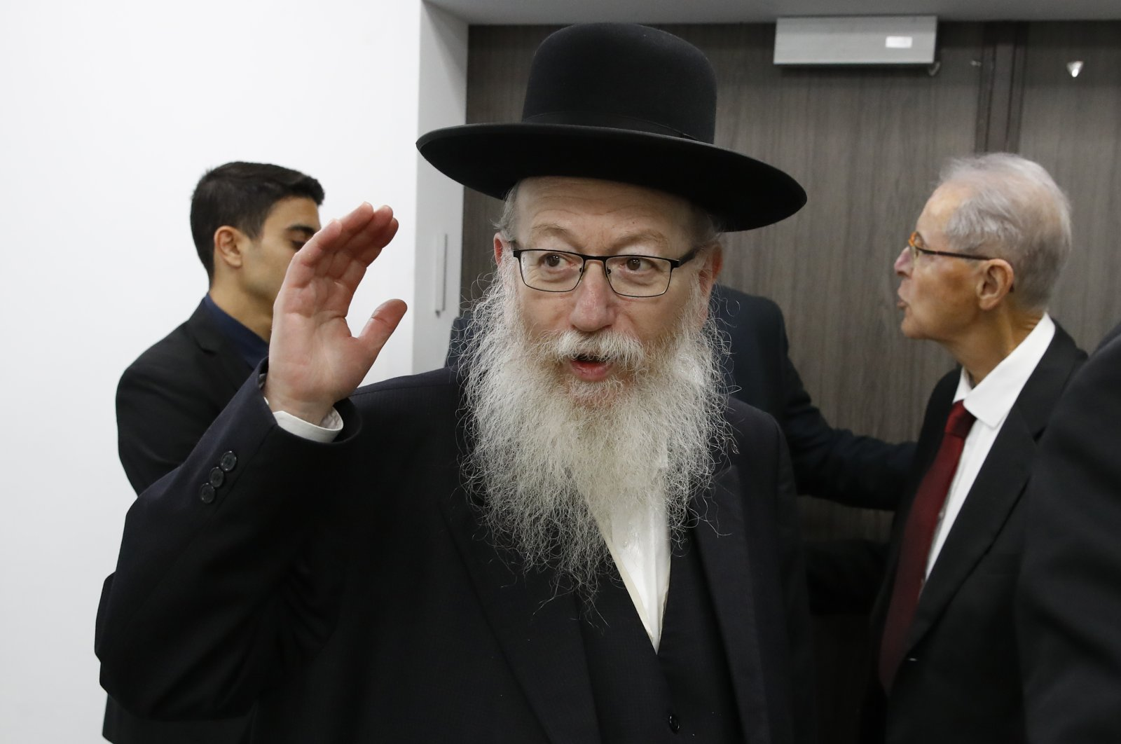 Israeli Health Minister Yaakov Litzman arrives for a situation assessment meeting with Prime Minister Benjamin Netanyahu and others regarding the coronavirus, Tel Aviv, Feb. 23, 2020. (AP Photo)