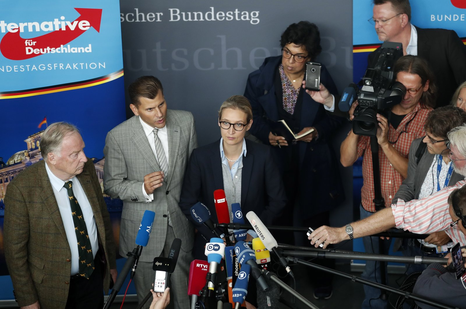 Christian Lueth (2nd from L), spokesman of the German right-wing populist party Alternative for Germany (AfD), and the co-top candidates for the general elections Alice Weidel (C) and Alexander Gauland (L) address the media prior to the first parliamentary group meeting of the party, in Berlin, Germany, Sept. 26, 2017. (EPA Photo)