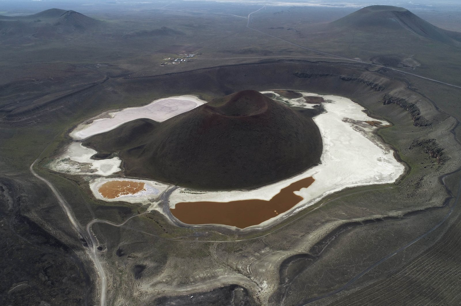 A giant volcanic cone stands in the center of Lake Meke, located in Konya, Turkey, April 26, 2020. (DHA Photo)