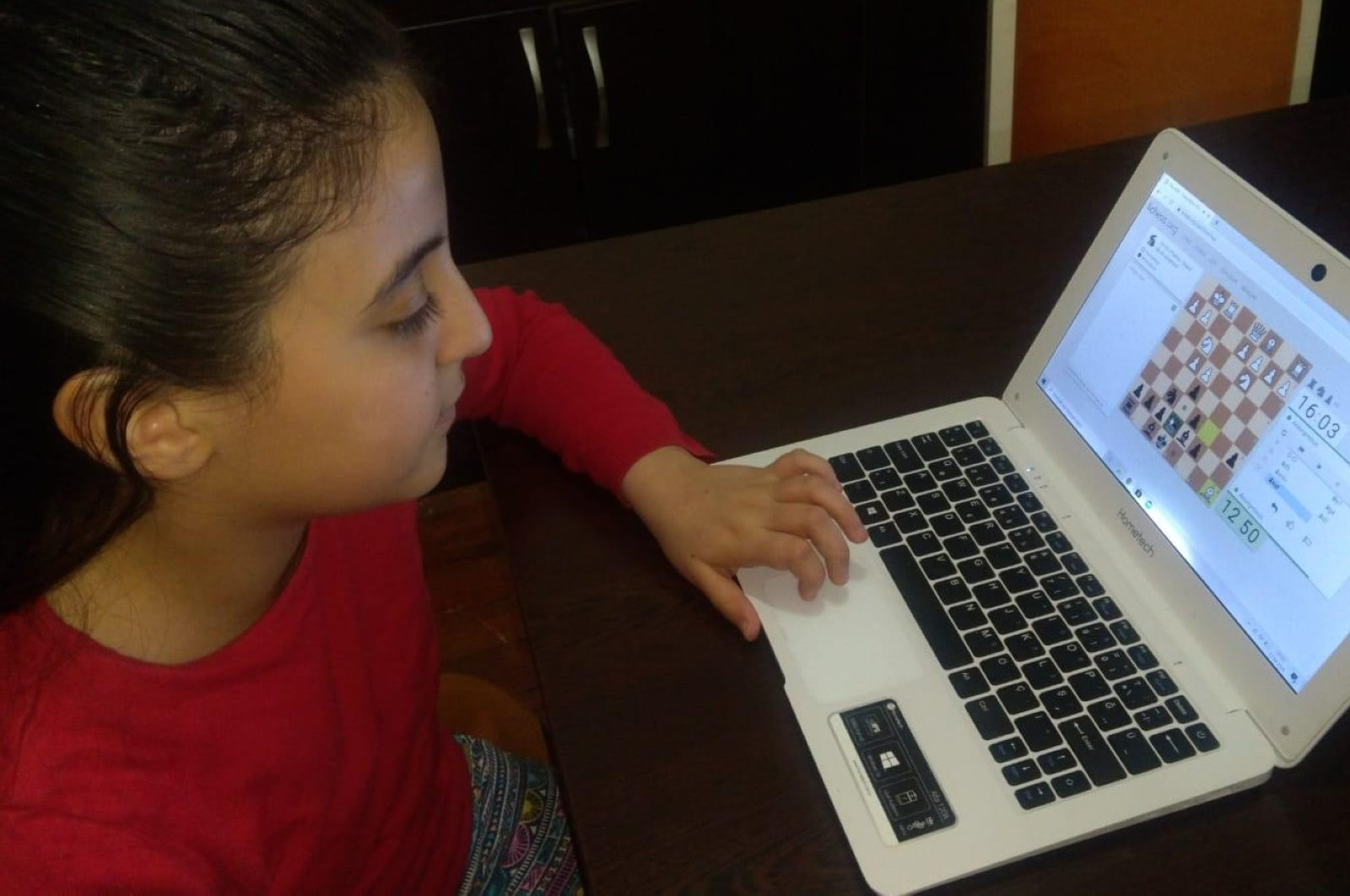 A girl takes part in an online chess tournament in Sivas, Turkey, April 24, 2020. (İHA Photo)
