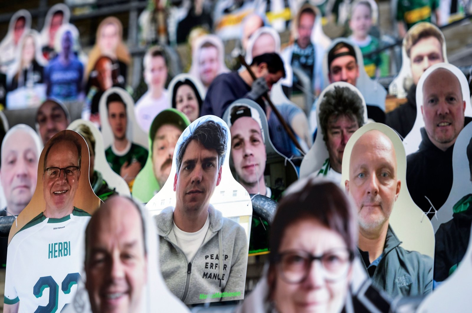 Cardboard cut-outs with portraits of Borussia Moenchengladbach's supporters are seen at the Borussia Park football stadium in Moenchengladbach, western Germany, amid the novel coronavirus COVID-19 pandemic, April 16, 2020. (AFP Photo)