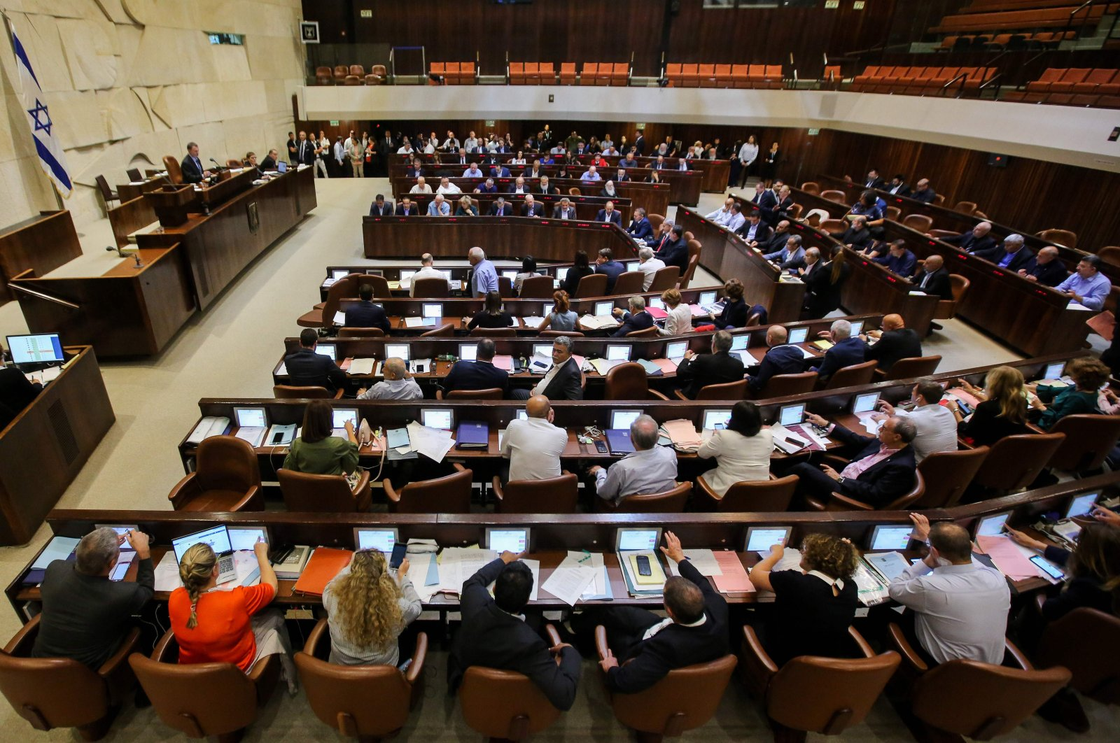 Israeli members of parliament attend the Knesset plenary hall session on July 18, 2018 (AFP File Photo)