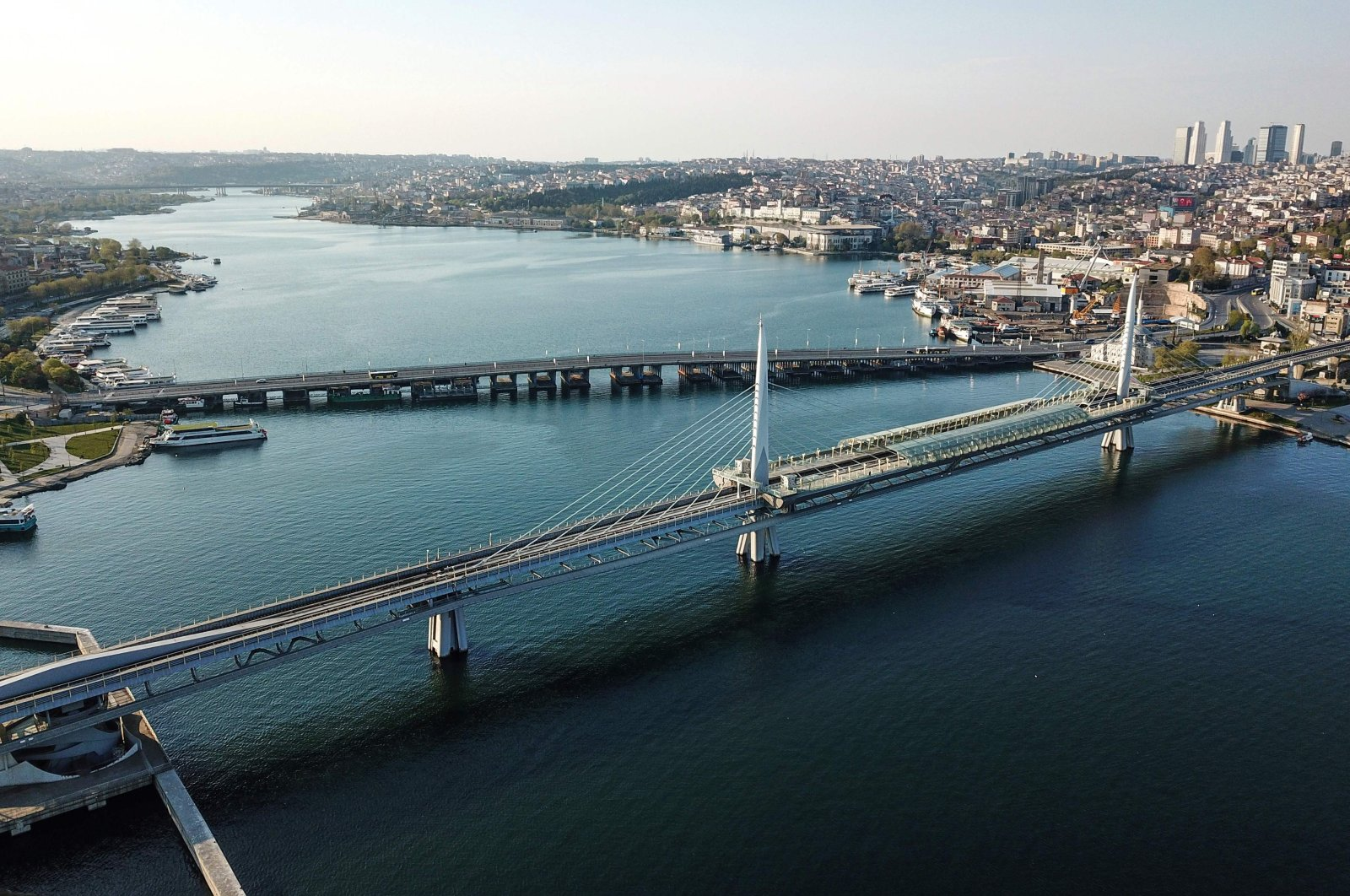The Unkapanı Bridge (back) and Metro Bridge (front) across the Golden Horn, in Istanbul, Turkey, during a four-day curfew to prevent the spread of the COVID-19 disease, April 26, 2020. (AFP Photo)