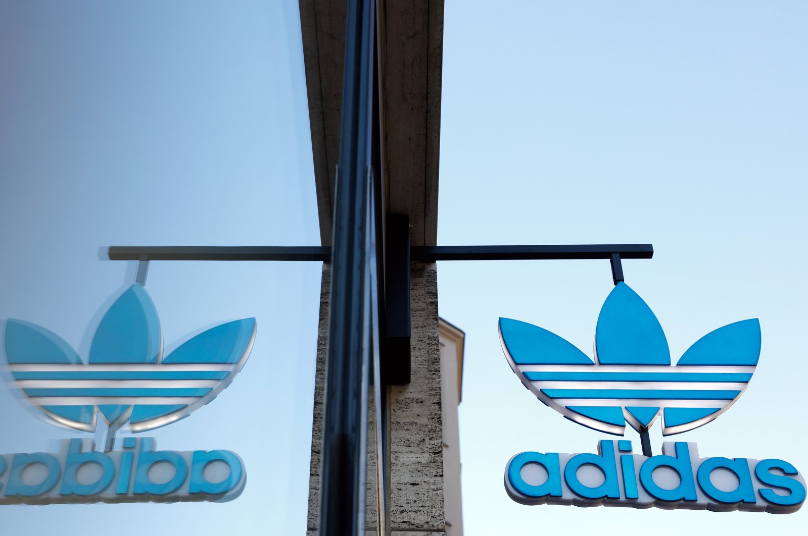 An Adidas shop is seen amid the coronavirus pandemic in Berlin, Germany, April 20, 2020. (Reuters Photo)