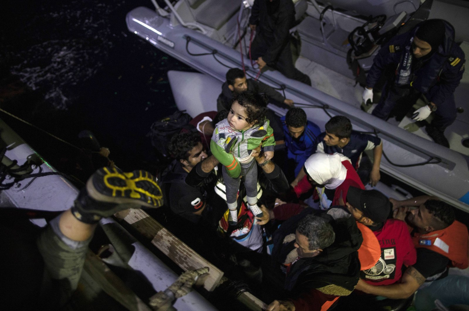 Refugees and migrants board a coast guard ship during a rescue operation on Sept. 26, 2019, near the Greek island from Samos. (AP Photo)