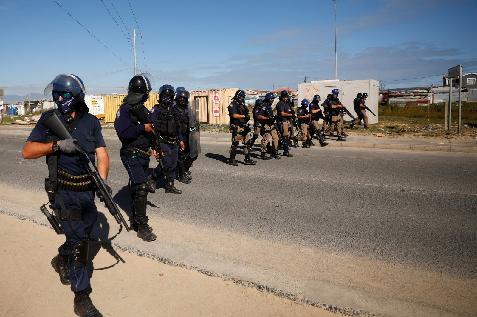 Police officers patrol the streets during a nationwide lockdown aimed at limiting the spread of the coronavirus disease (COVID-19), Cape Town, April 21, 2020. (REUTERS Photo)
