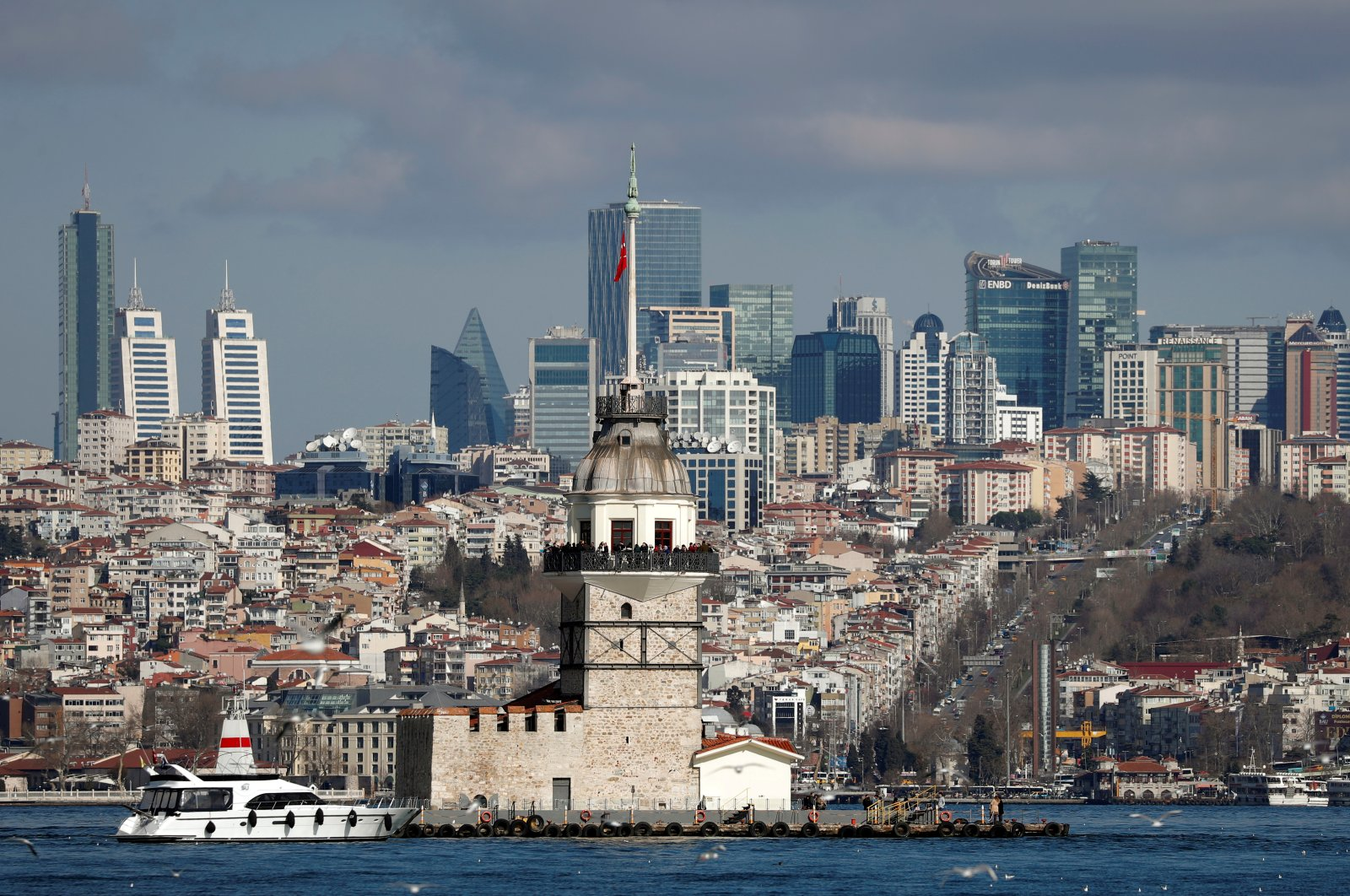 Maiden's Tower, an islet on the Bosporus, is pictured with the city's skyscrapers in the background, in Istanbul, Turkey, Feb. 23, 2020. (Reuters Photo)