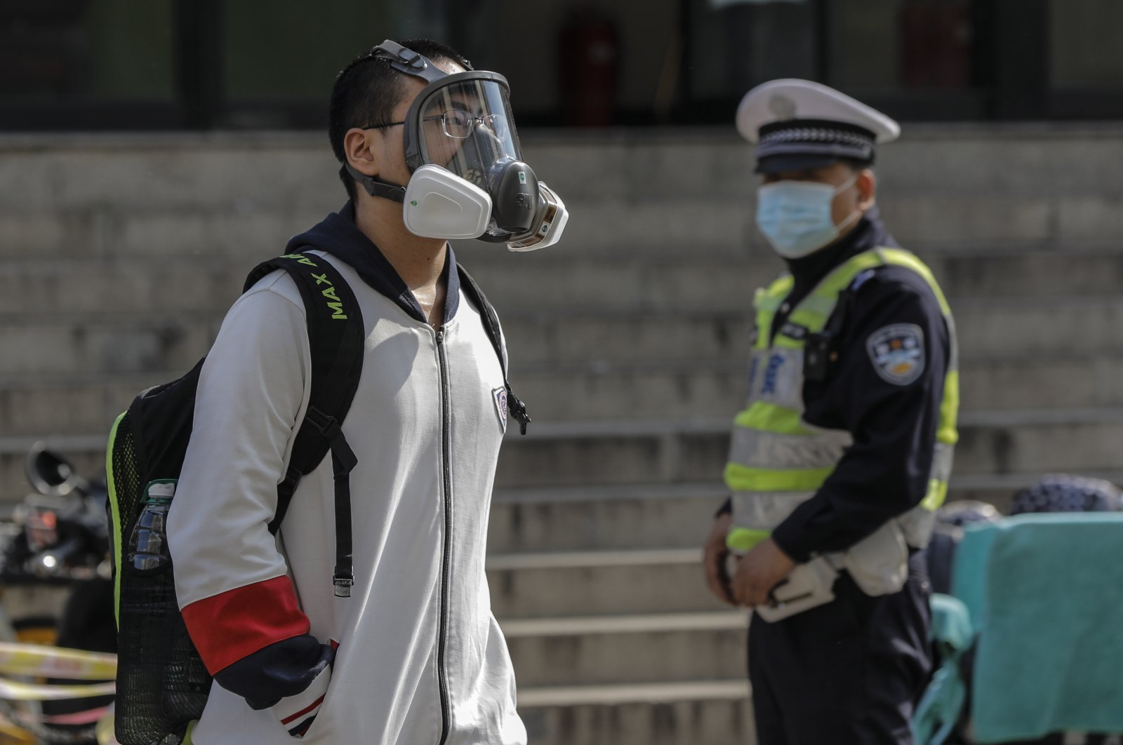 A student wearing a face mask leaves a high school in Beijing, China, 27 April 2020. Senior students in Beijing return to class for the first time after schools were closed down in January due to the outbreak of the coronavirus and COVID-19 disease. (EPA Photo)