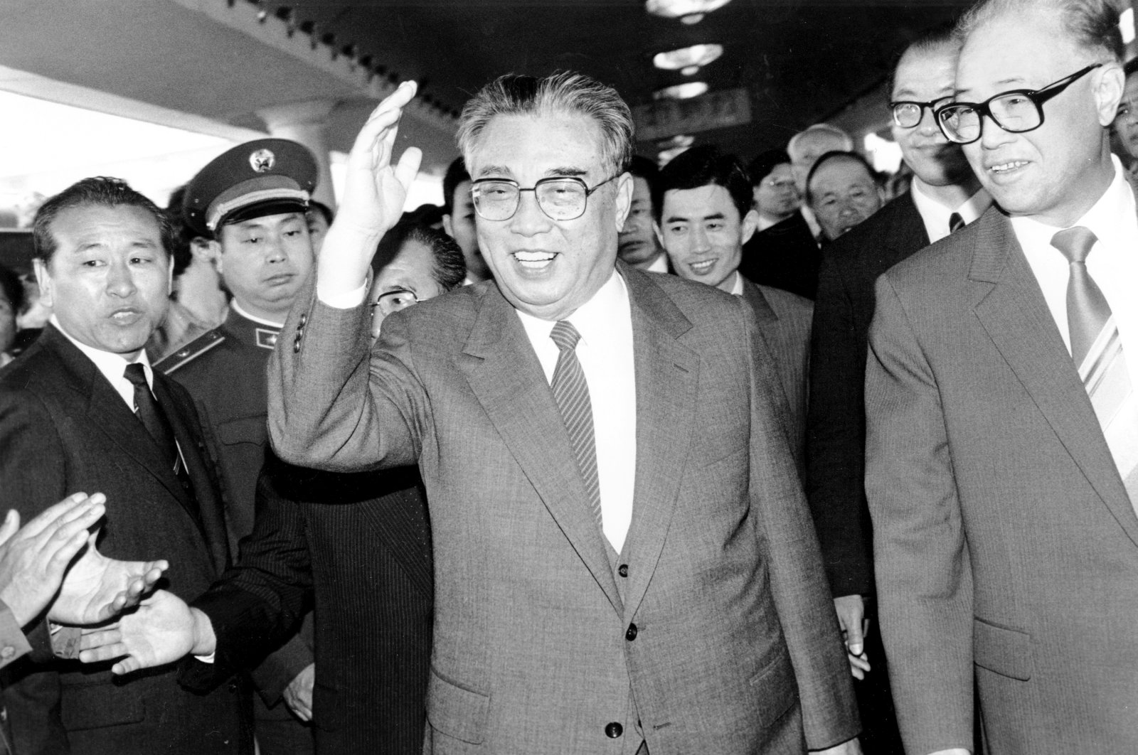 In this May 21, 1987, file photo, then North Korean President Kim Il Sung, center, and then Chinese Premier Zhao Ziyang make their way through a crowd of well-wishers at the train station in Beijing. (AP Photo)