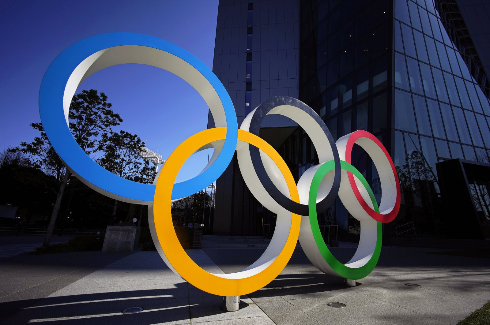 The Olympic Rings monument in front of the Japan Olympic Committee headquarters in Tokyo, Japan, Tuesday, March 24, 2020. (EPA Photo)