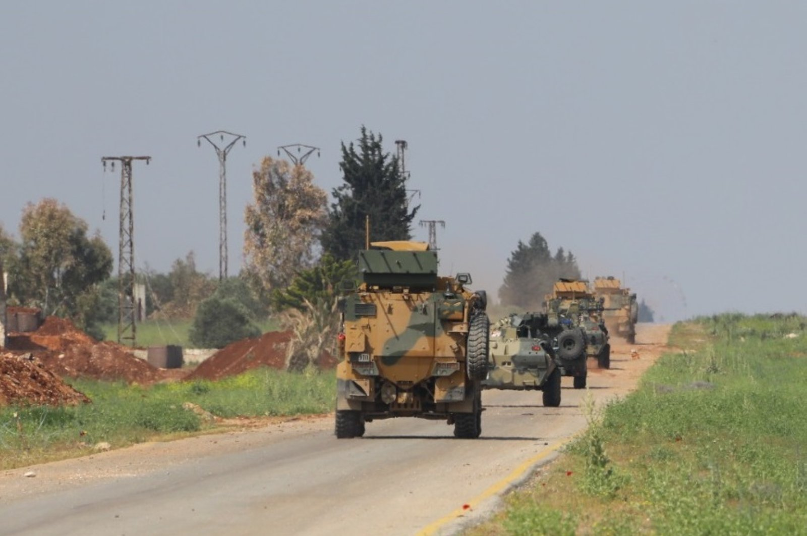 Turkey, Russia hold a sixth joint patrol on M4 highway with the participation of land, aerial elements, Idlib, Syria, April 28, 2020.  (DHA Photo)