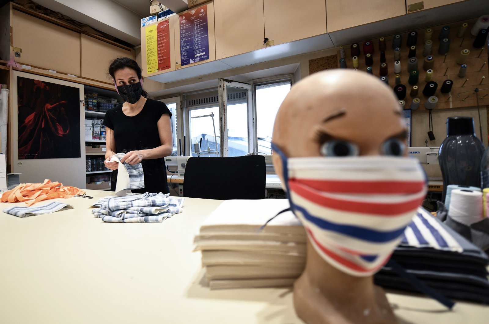 A seamstress from the Opera de Marseille makes face masks out of fabric in the sewing workshop of the Marseille opera house, April 20, 2020, in Marseille, southeastern France. (AFP Photo)