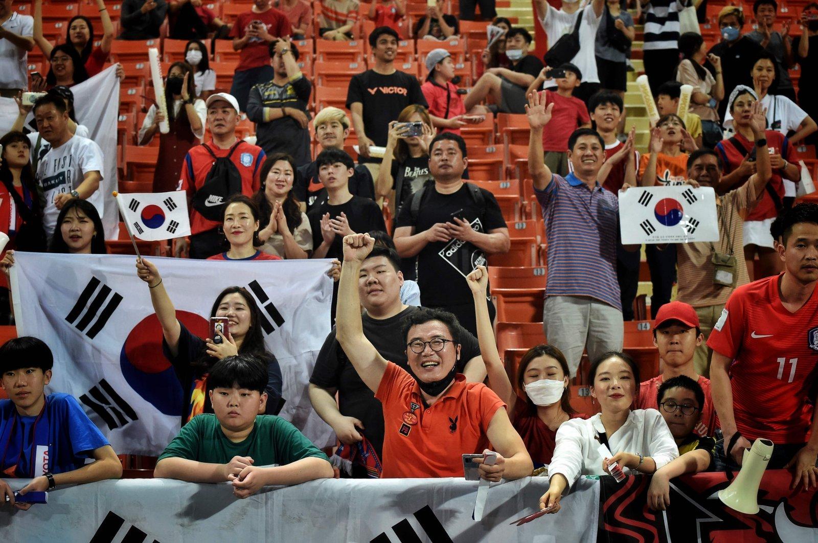 South Korean football fans celebrate winning the AFC U-23 Championship final football match between Saudi Arabia and South Korea, in Bangkok, Thailand, Jan. 26, 2020. (AFP Photo)
