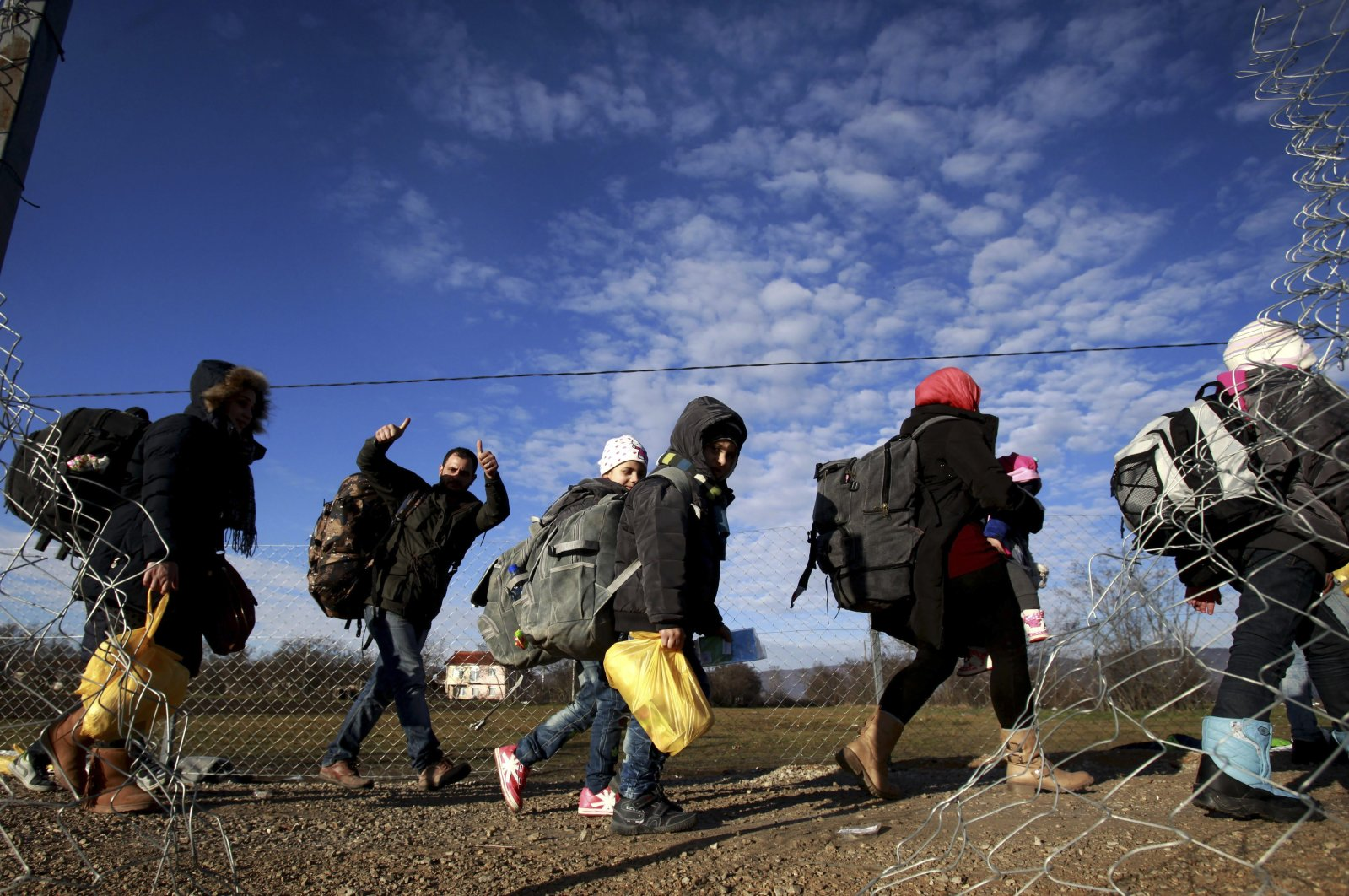 Asylum-seekers walk towards the border with Serbia from the transit center for refugees near northern Macedonian village of Tabanovce, February 12, 2016. (AP Photo)