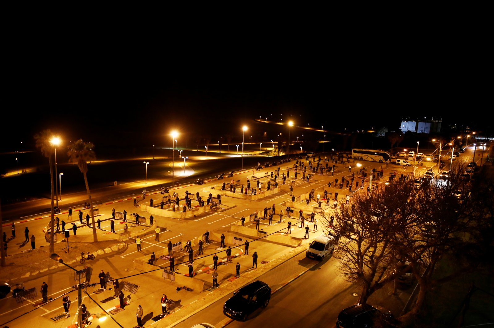 Muslim worshippers pray in an empty parking lot in the ancient Israeli port city of Jaffa for Ramadan prayers as mosques are closed due to the coronavirus pandemic, April 27, 2020. (Reuters Photo)