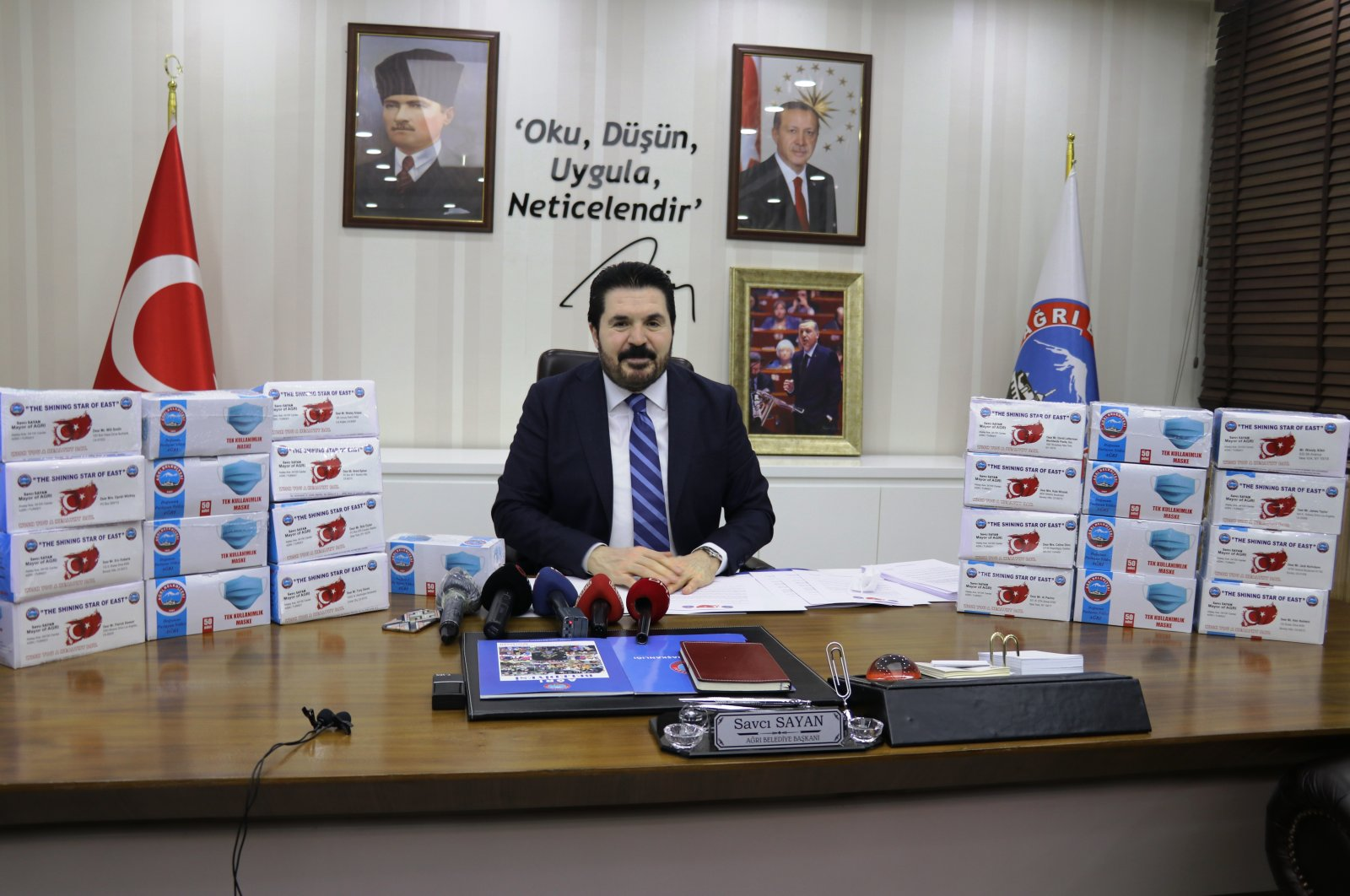 Ağrı Mayor Savcı Sayan poses with the boxes of masks to be sent to U.S., in northeastern Ağrı province, Turkey, April 28, 2020. (AA Photo)