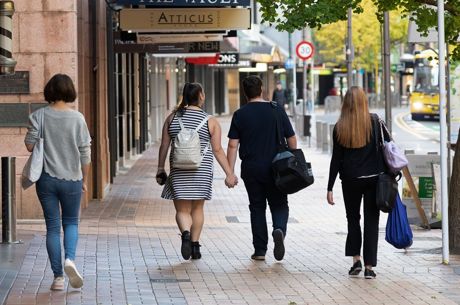People walk down a street on the first day of the easing of restrictions, Wellington, New Zealand, April 28, 2020. (AFP Photo)