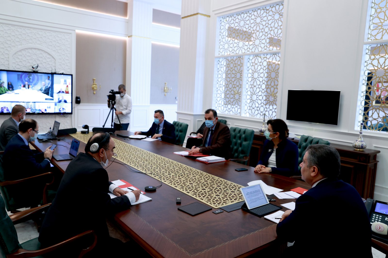 Turkish Health Minister Fahrettin Koca (R) and other officials attend to the videoconference held between counterparts from the Turkic Council, in Ankara, on April 28, 2020. (AA Photo)