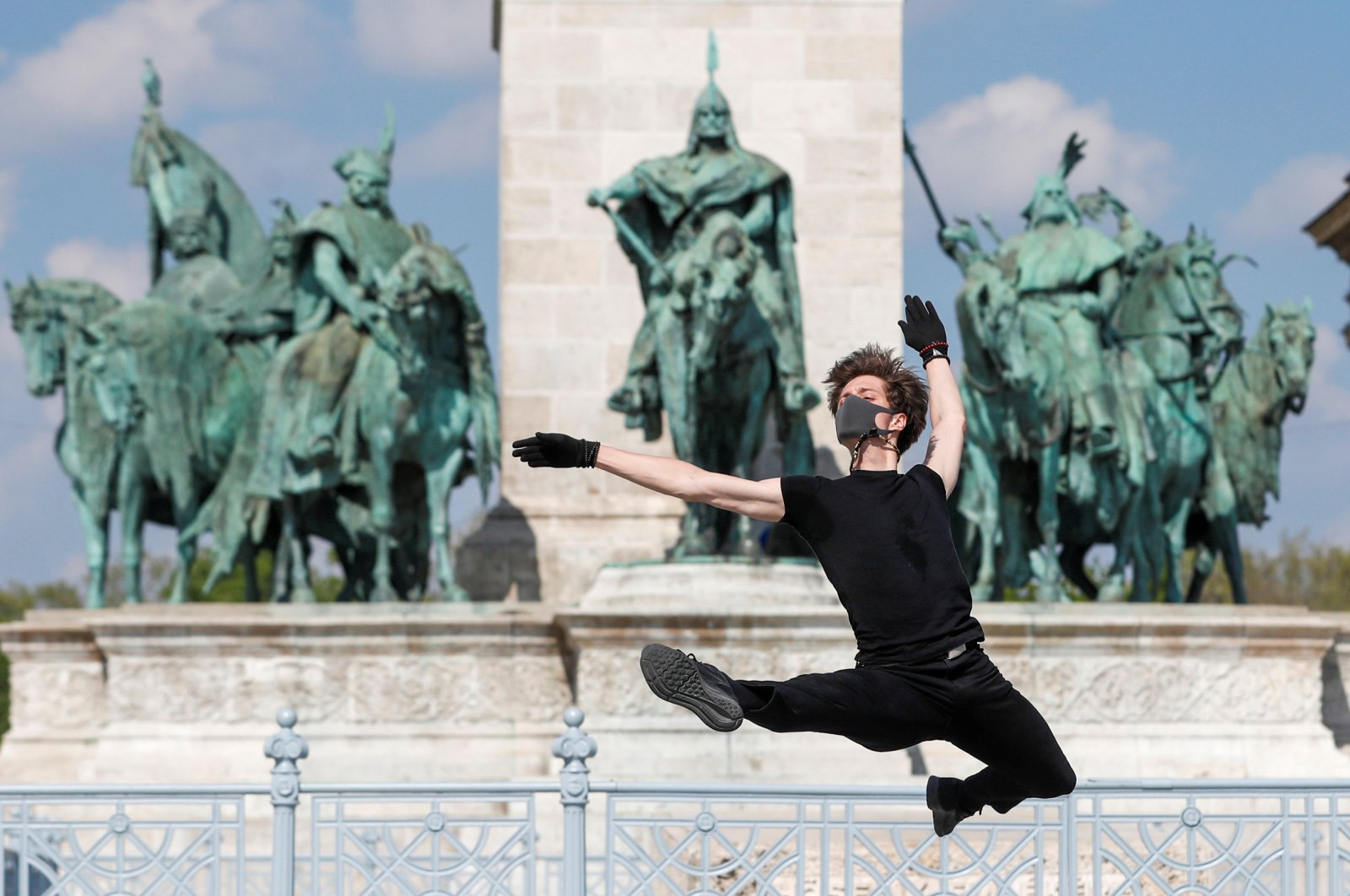 """Hungarian ballet dancer Zsolt Kovacs performs a choreographic piece he has designed for the """"coronavirus melody,"""" a musical composition created by MIT scientists from a model of the protein structure of SARS-CoV-2, during the coronavirus disease outbreak in Budapest, Hungary, April 28, 2020. (Reuters Photo)"""