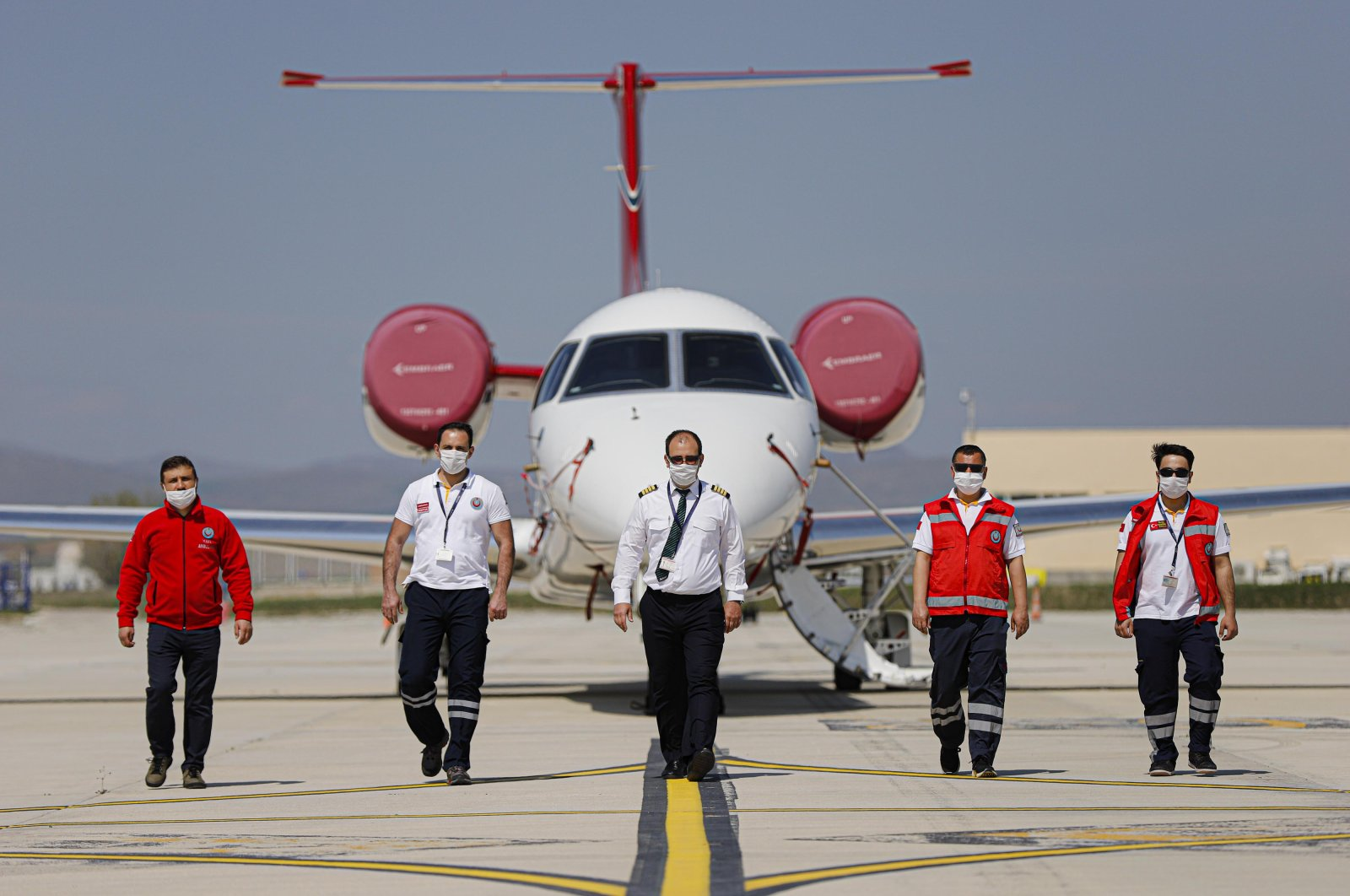 The crew of an air ambulance poses in front of the aircraft, in Ankara, Turkey, April 29, 2020. (DHA Photo)