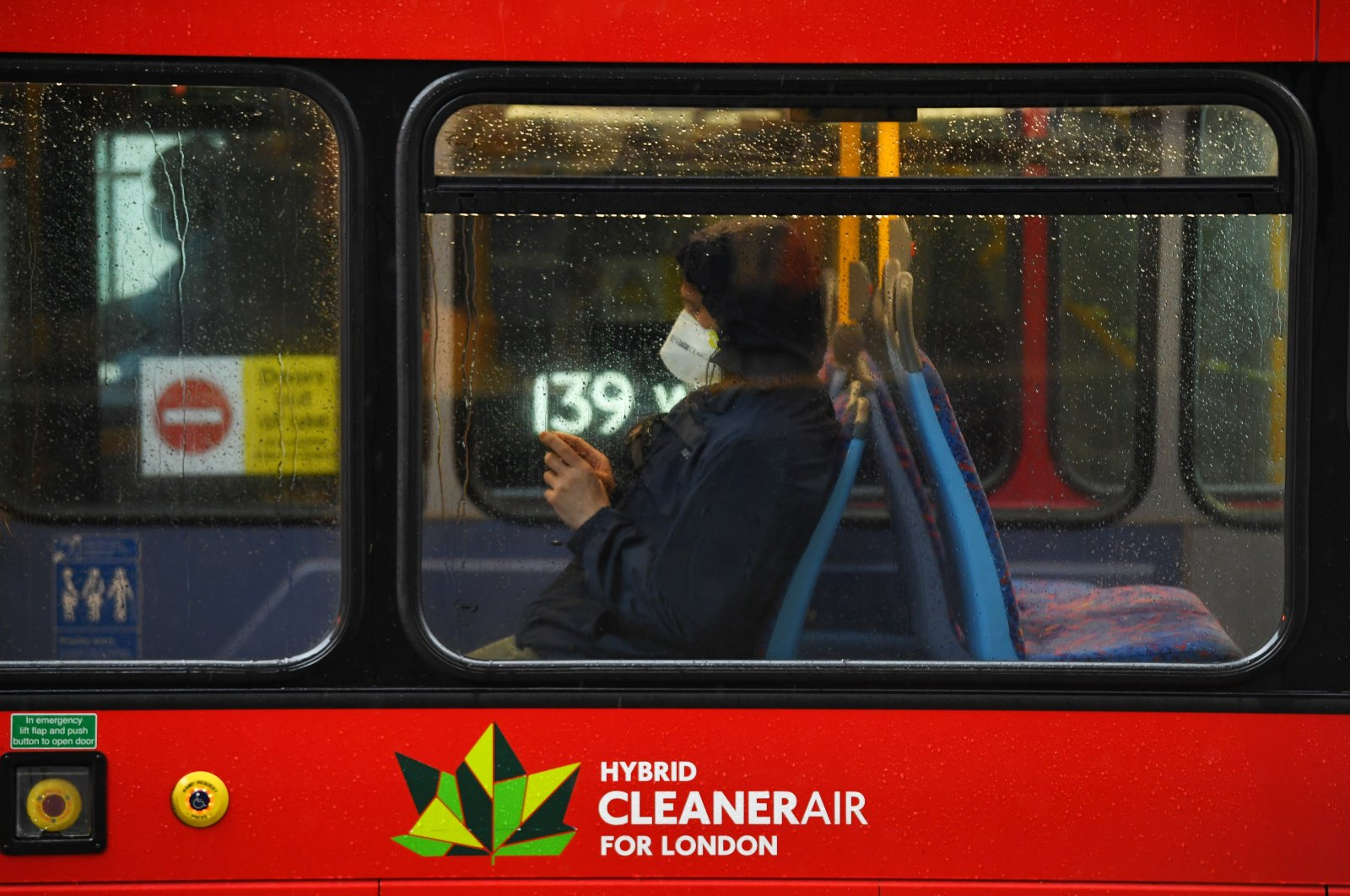 A person is seen wearing a mask on a bus on Oxford Street, as the COVID-19 outbreak continues, London, Britain, April 28, 2020. (Reuters Photo)