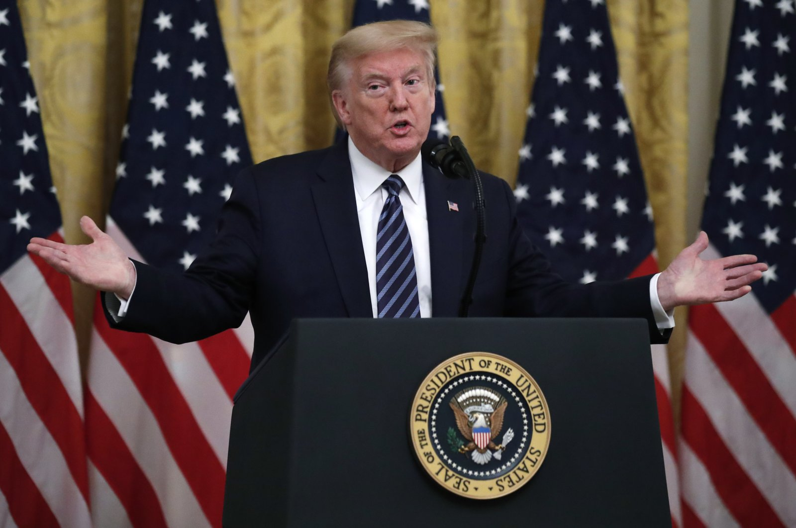 President Donald Trump answers questions from reporters during a event about protecting seniors, in the East Room of the White House, Thursday, April 30, 2020, in Washington. (AP Photo)