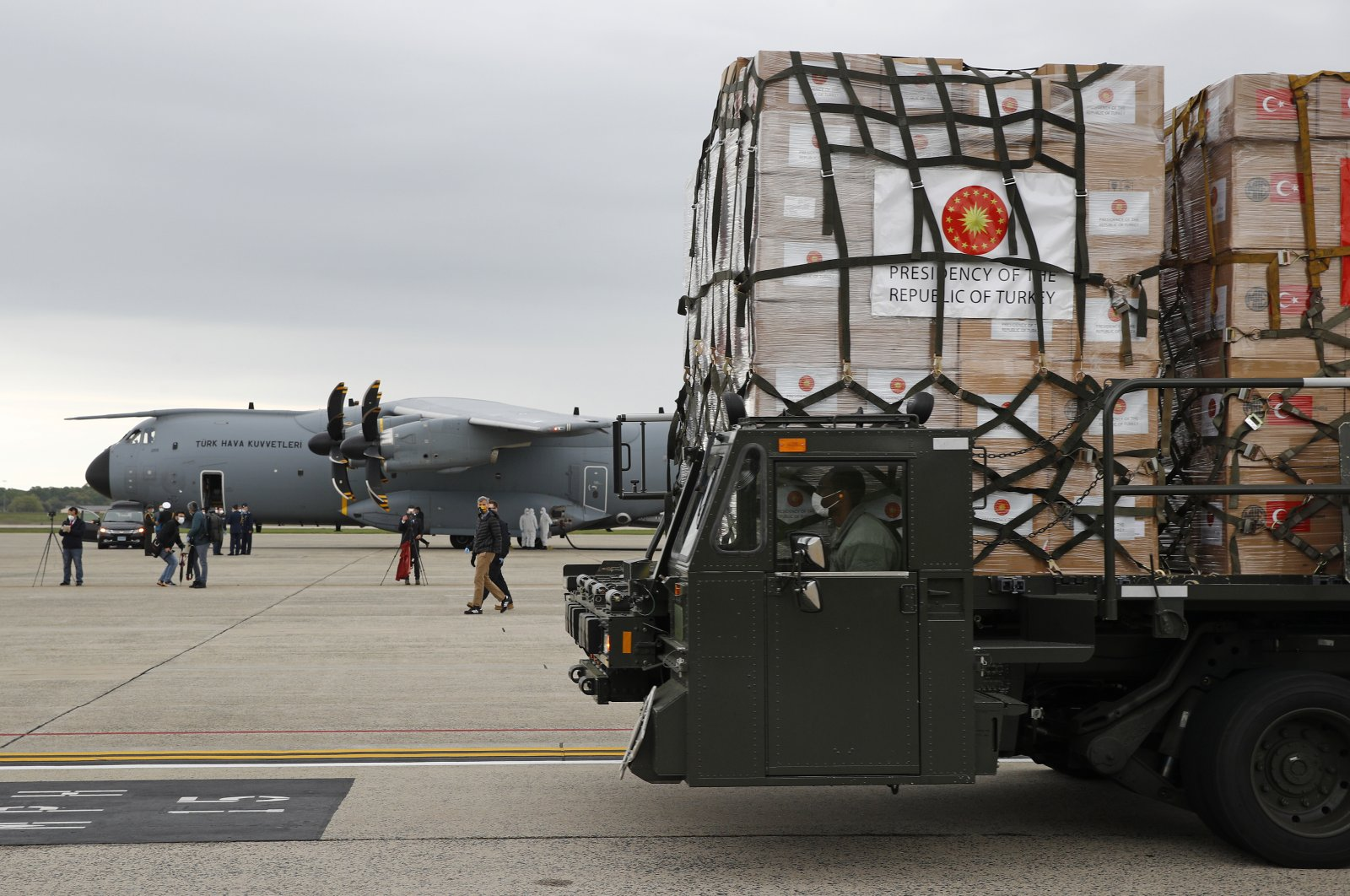 A U.S. Air Force vehicle carries a donation of medical supplies from Turkey after it was unloaded from a military plane, at Andrews Air Force Base, Maryland, April 28, 2020. (AP Photo)