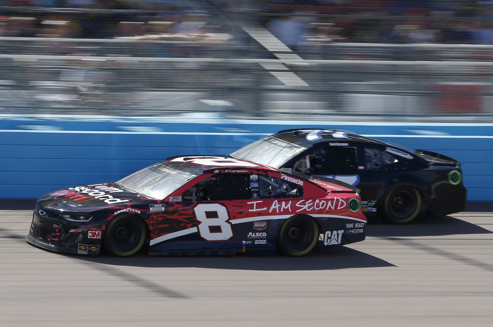 Tyler Reddick races past Reed Sorenson during a NASCAR race in Avondale, Arizona, March 8, 2020. (AP Photo)