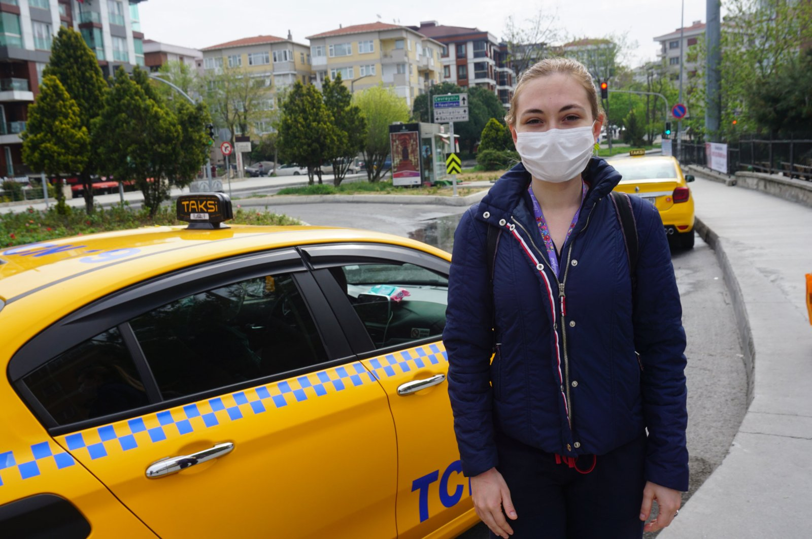 Naz Alibaşoğlu, a health worker that had finished her shift and benefitted from the taxi service, expresses her admiration of the practice, Istanbul, May 1, 2020. (DHA Photo)