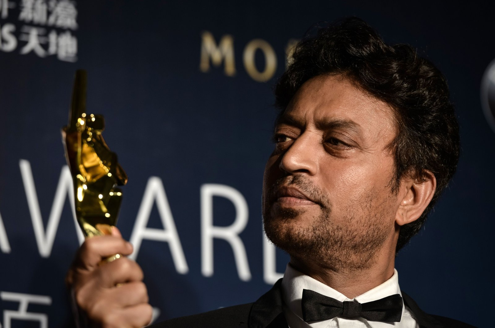 In this file photo from March 27, 2014, Best Actor winner Irrfan Khan poses with his trophy during the Asian Film Awards in Macau. (AFP Photo)