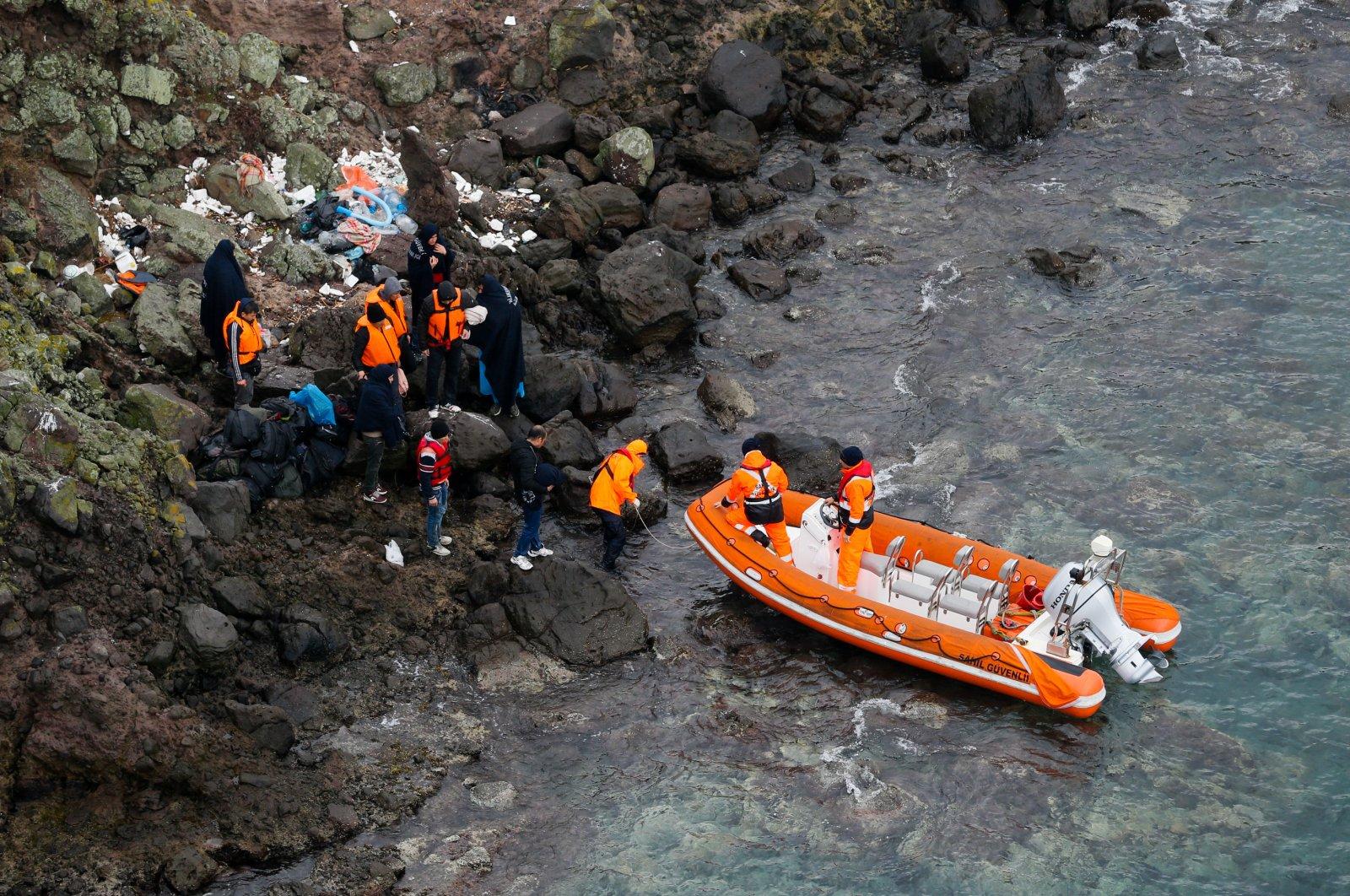 Turkish coast guards rescue 44 illegal migrants stuck on an island on the Aegean Sea, Nov.11, 2018. (AA Photo)